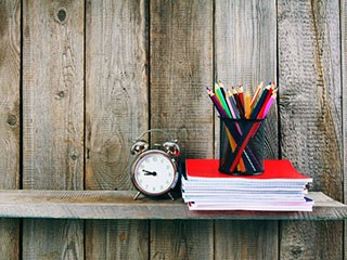clock with books and pens SQUARE.jpg